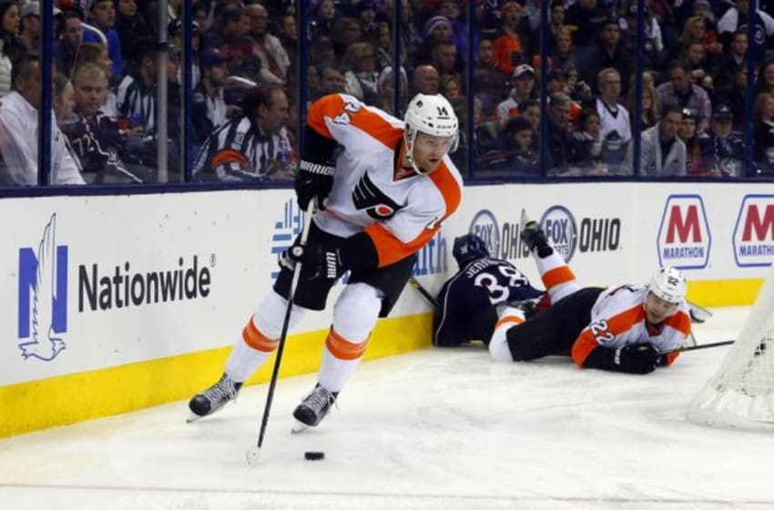 Dec 19, 2015; Columbus, OH, USA; Philadelphia Flyers center Sean Couturier (14) skates with the puck against the Columbus Blue Jackets during the second period at Nationwide Arena. Mandatory Credit: Russell LaBounty-USA TODAY Sports
