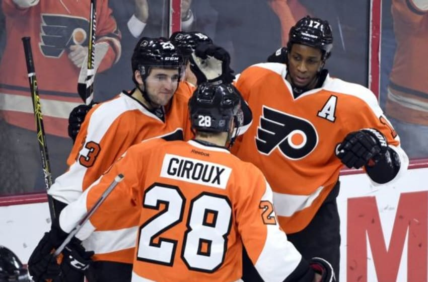 Jan 25, 2016; Philadelphia, PA, USA; Philadelphia Flyers right wing Wayne Simmonds (17) celebrates his goal with defenseman Brandon Manning (23) and center Claude Giroux (28) against the Boston Bruins during the third period at Wells Fargo Center. The Burins defeated the Flyers, 3-2. Mandatory Credit: Eric Hartline-USA TODAY Sports