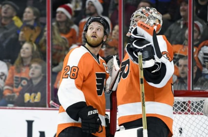Dec 17, 2015; Philadelphia, PA, USA; Philadelphia Flyers center Claude Giroux (28) and goalie Steve Mason (35) watch video replay of Flyers goal against the Vancouver Canucks during the first period at Wells Fargo Center. Mandatory Credit: Eric Hartline-USA TODAY Sports