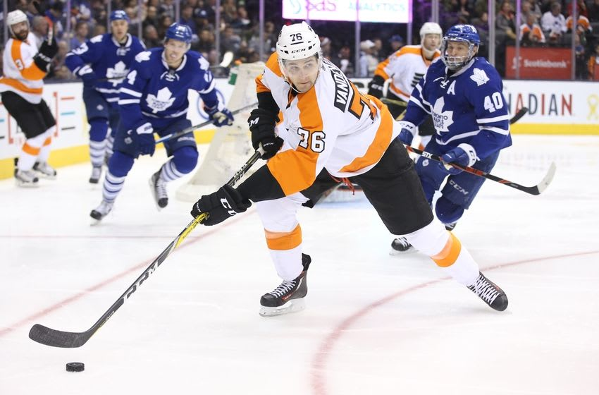 Feb 20, 2016; Toronto, Ontario, CAN; Philadelphia Flyers center Chris VandeVelde (76) picks up the puck against the Toronto Maple Leafs at Air Canada Centre. The Flyers beat the Maple Leafs 5-4 in overtime. Mandatory Credit: Tom Szczerbowski-USA TODAY Sports
