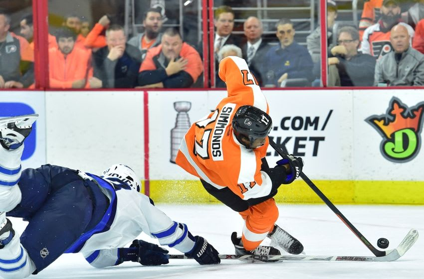 Mar 28, 2016; Philadelphia, PA, USA; Winnipeg Jets defenseman Dustin Byfuglien (33) upends Philadelphia Flyers right wing Wayne Simmonds (17) during the second period at Wells Fargo Center. Mandatory Credit: Eric Hartline-USA TODAY Sports