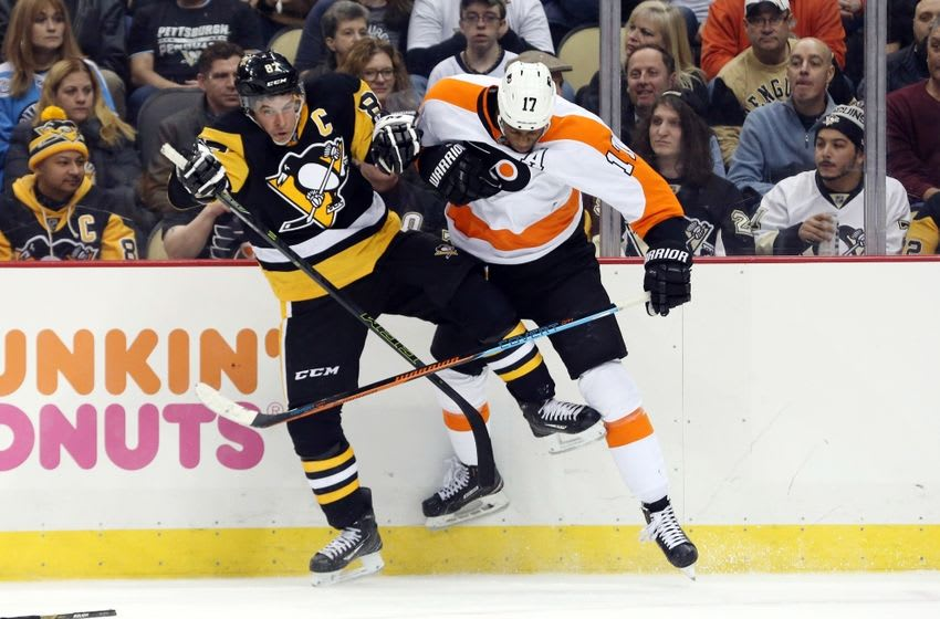 Jan 21, 2016; Pittsburgh, PA, USA; Pittsburgh Penguins center Sidney Crosby (87) and Philadelphia Flyers right wing Wayne Simmonds (17) collide along the boards during the third period at the CONSOL Energy Center. The Penguins won 4-3. Mandatory Credit: Charles LeClaire-USA TODAY Sports