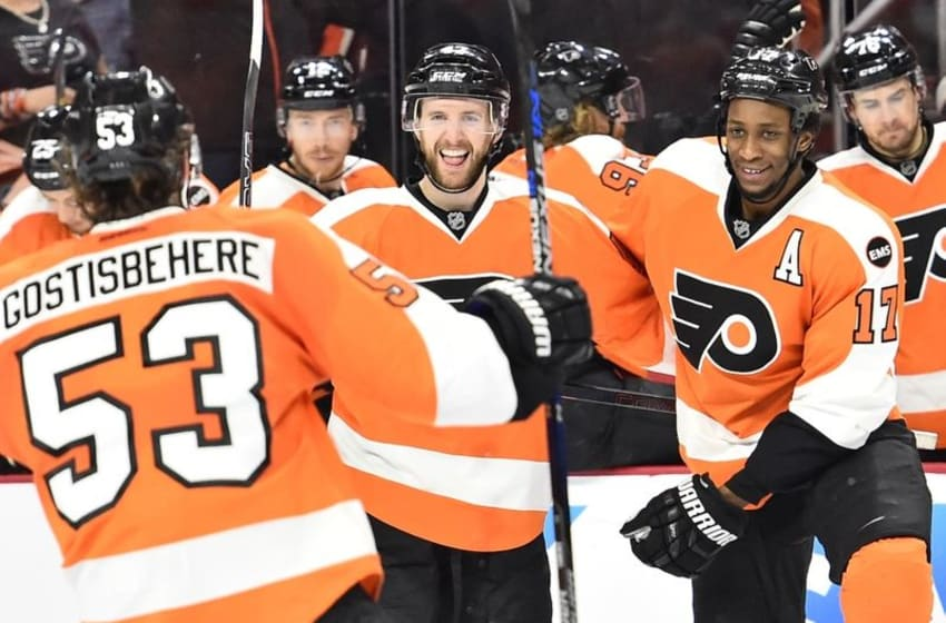 Apr 20, 2016; Philadelphia, PA, USA; Philadelphia Flyers defenseman Andrew MacDonald (47) celebrates with defenseman Shayne Gostisbehere (53) and right wing Wayne Simmonds (17) after scoring a goal against the Washington Capitals during the second period in game four of the first round of the 2016 Stanley Cup Playoffs at Wells Fargo Center. Mandatory Credit: Eric Hartline-USA TODAY Sports