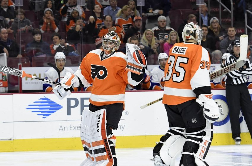 Dec 8, 2015; Philadelphia, PA, USA; Philadelphia Flyers goalie Michal Neuvirth (30) enters the game after replacing goalie Steve Mason (35) against the New York Islanders during the second period at Wells Fargo Center. Mandatory Credit: Eric Hartline-USA TODAY Sports