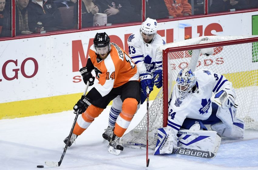 Jan 19, 2016; Philadelphia, PA, USA; Philadelphia Flyers center Sean Couturier (14) carries the puck against Toronto Maple Leafs center Nazem Kadri (43) and goalie James Reimer (34) during the third period at Wells Fargo Center. The Maple Leafs defeated the Flyers, 3-2. Mandatory Credit: Eric Hartline-USA TODAY Sports