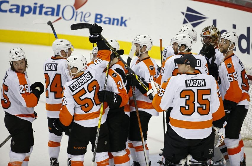 Apr 22, 2016; Washington, DC, USA; Philadelphia Flyers goalie Michal Neuvirth (30) celebrates with teammates after the Flyers
