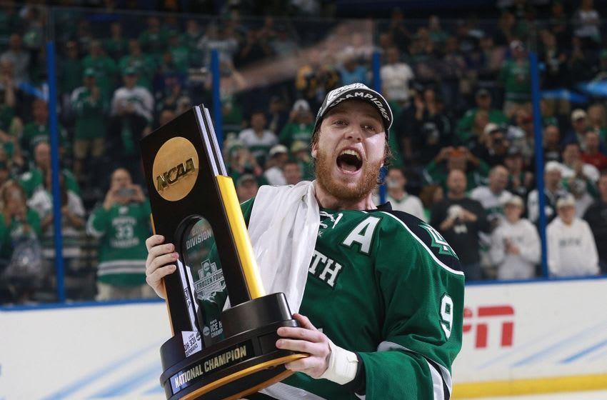 Apr 9, 2016; Tampa, FL, USA; North Dakota Fighting Hawks forward Drake Caggiula (9) skates around with the trophy after beating the Quinnipiac Bobcats in the championship game of the 2016 Frozen Four college ice hockey tournament at Amalie Arena. North Dakota defeated Quinnipiac 5-1. Mandatory Credit: Kim Klement-USA TODAY Sports