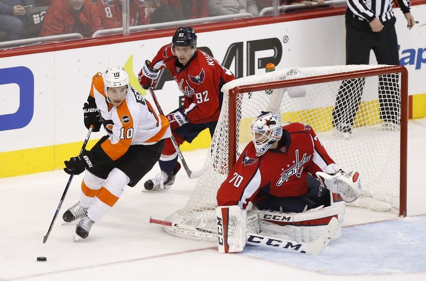 Apr 16, 2016; Washington, DC, USA; Washington Capitals goalie Braden Holtby (70) prepares to make a save on Philadelphia Flyers center Brayden Schenn (10) as Capitals center Evgeny Kuznetsov (92) defends in the third period in game two of the first round of the 2016 Stanley Cup Playoffs at Verizon Center. The Capitals won 4-1, and lead the series 2-0. Mandatory Credit: Geoff Burke-USA TODAY Sports