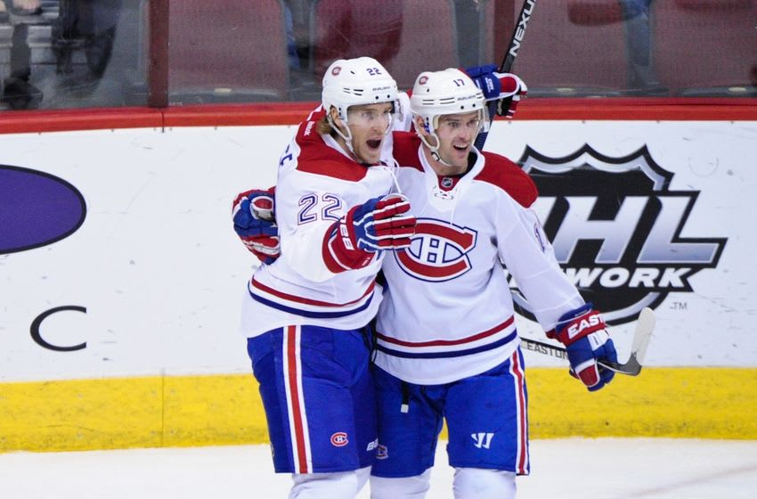Feb 15, 2016; Glendale, AZ, USA; Montreal Canadiens right wing Dale Weise (22) celebrates with center Torrey Mitchell (17) after scoring a goal in the first period against the Arizona Coyotes at Gila River Arena. Mandatory Credit: Matt Kartozian-USA TODAY Sports