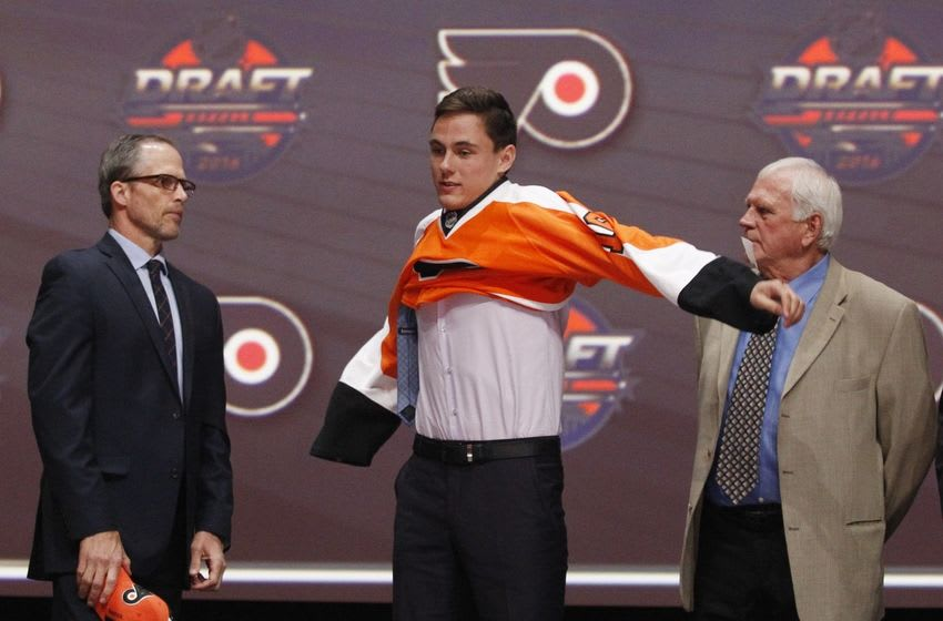 Jun 24, 2016; Buffalo, NY, USA; German Rubtsov puts on a team jersey after being selected as the number twenty-two overall draft pick by the Philadelphia Flyers in the first round of the 2016 NHL Draft at the First Niagra Center. Mandatory Credit: Timothy T. Ludwig-USA TODAY Sports