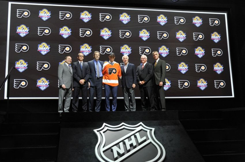 Jun 26, 2015; Sunrise, FL, USA; Ivan Provorov poses for a photo with team executives after being selected as the number seven overall pick to the Philadelphia Flyers in the first round of the 2015 NHL Draft at BB&T Center. Mandatory Credit: Steve Mitchell-USA TODAY Sports