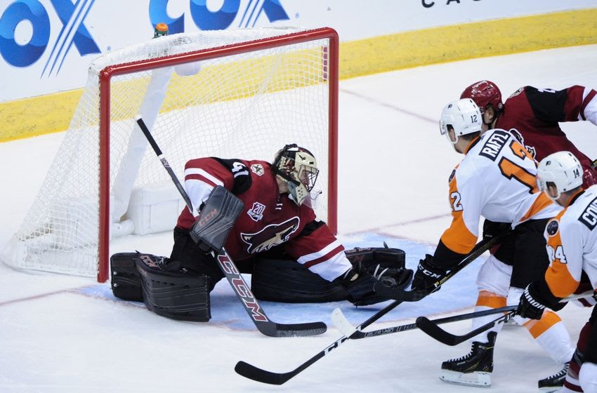 Oct 15, 2016; Glendale, AZ, USA; Arizona Coyotes goalie Mike Smith (41) makes a save as Philadelphia Flyers left wing Michael Raffl (12) and center Sean Couturier (14) attack during the first period at Gila River Arena. Mandatory Credit: Matt Kartozian-USA TODAY Sports