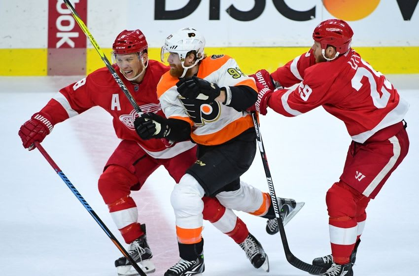 Nov 2, 2016; Philadelphia, PA, USA; Philadelphia Flyers right wing Jakub Voracek (93) is checked by Detroit Red Wings left wing Justin Abdelkader (8) and center Steve Ott (29) during the third period at Wells Fargo Center. The Flyers defeated the Red Wings, 4-3 in overtime. Mandatory Credit: Eric Hartline-USA TODAY Sports
