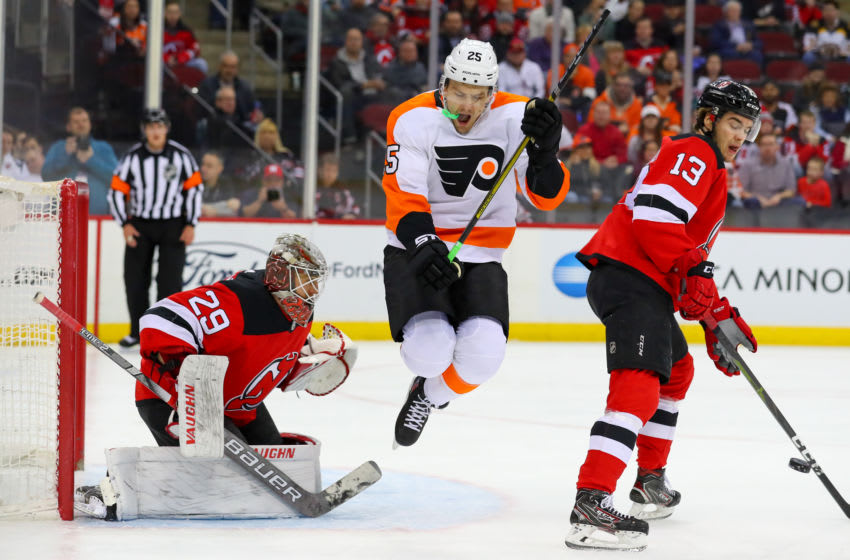 NEWARK, NJ - JANUARY 12: Philadelphia Flyers left wing James van Riemsdyk (25) jumps in front of New Jersey Devils goaltender Mackenzie Blackwood (29) during the first period of the National Hockey League game between the New Jersey Devils and the Philadelphia Flyers on January 12, 2019 at the Prudential Center in Newark, NJ. (Photo by Rich Graessle/Icon Sportswire via Getty Images)