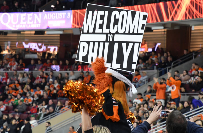 PHILADELPHIA, PA - MARCH 06: Gritty holds a sign welcoming Bryce Harper to Philadelphia during the game between the Washington Capitals and the Philadelphia Flyers on March 6, 2019 at Wells Fargo Center in Philadelphia, PA.(Photo by Andy Lewis/Icon Sportswire via Getty Images)