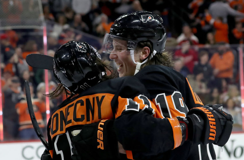 PHILADELPHIA, PENNSYLVANIA - FEBRUARY 16: Travis Konecny #11 of the Philadelphia Flyers is congratulated by Nolan Patrick #19 after Konecny scored the game winning goal in overtime at Wells Fargo Center on February 16, 2019 in Philadelphia, Pennsylvania.The Philadelphia Flyers defeated the Detroit Red Wings 6-5 in overtime. (Photo by Elsa/Getty Images)