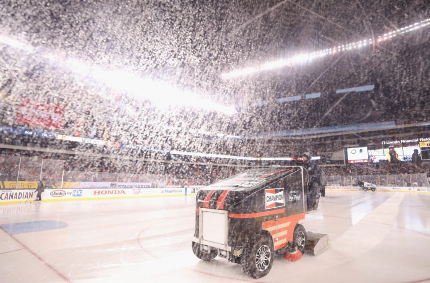PHILADELPHIA, PENNSYLVANIA - FEBRUARY 23: A small ice resurfacing machine works through the pre-game rain during the 2019 Coors Light NHL Stadium Series game at the Lincoln Financial Field on February 23, 2019 in Philadelphia, Pennsylvania. (Photo by Bruce Bennett/Getty Images)