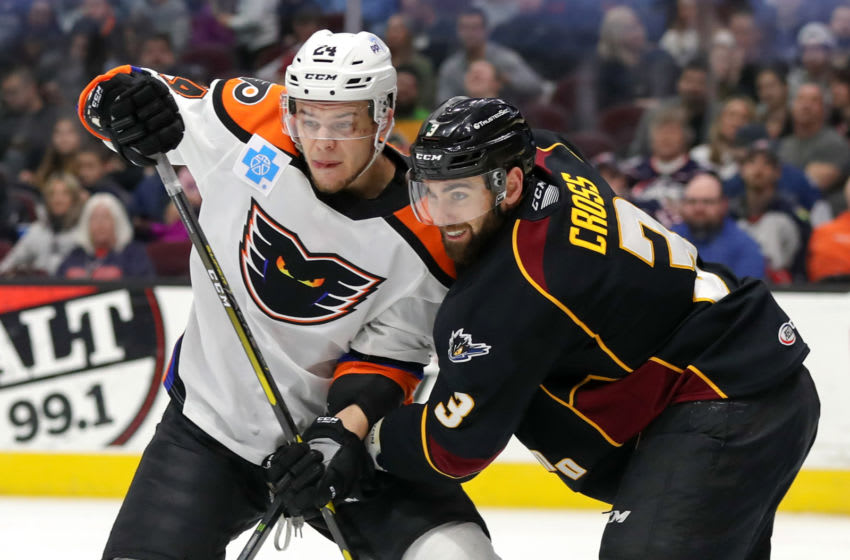 CLEVELAND, OH - MARCH 29: Cleveland Monsters defenceman Tommy Cross (3) defends Lehigh Valley Phantoms left wing Carsen Twarynski (24) during the first period of the American Hockey League game between the Lehigh Valley Phantoms and Cleveland Monsters on March 29, 2019, at Quicken Loans Arena in Cleveland, OH. (Photo by Frank Jansky/Icon Sportswire via Getty Images)