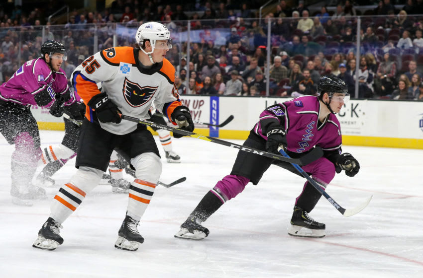 CLEVELAND, OH - MARCH 30: Lehigh Valley Phantoms center Connor Bunnaman (25) and Cleveland Monsters center Alexandre Texier (13) follow the puck into the corner during the third period of the American Hockey League game between the Lehigh Valley Phantoms and Cleveland Monsters on March 30, 2019, at Quicken Loans Arena in Cleveland, OH. (Photo by Frank Jansky/Icon Sportswire via Getty Images)