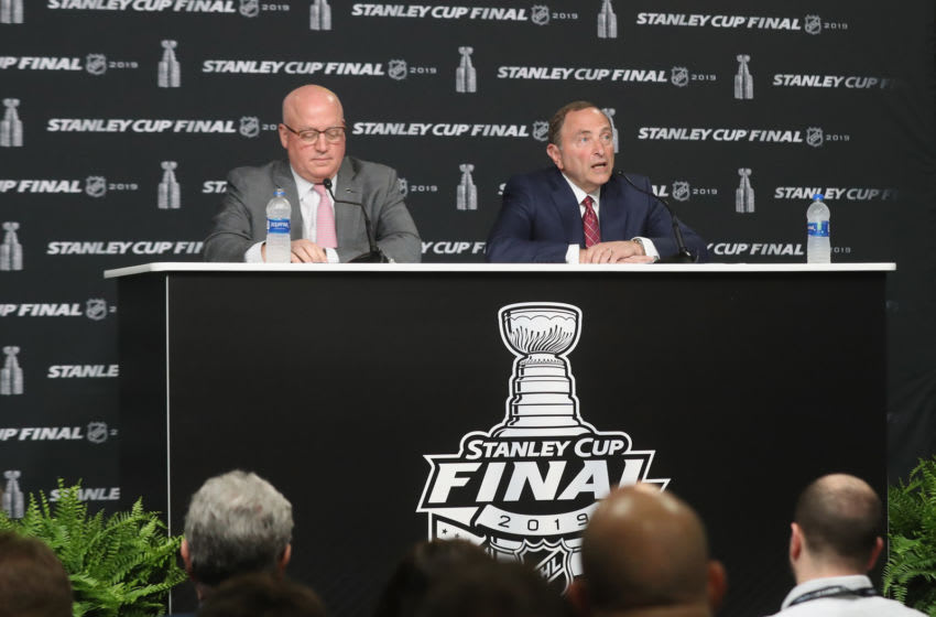 BOSTON, MASSACHUSETTS - MAY 27: (L-R) Deputy commissioner Bill Daly and Commissioner Gary Bettman of the National Hockey League speak with the media prior to Game One of the 2019 NHL Stanley Cup Final at TD Garden on May 27, 2019 in Boston, Massachusetts. (Photo by Bruce Bennett/Getty Images)