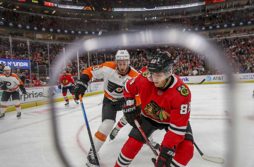 The Philadelphia Flyers' Kevin Hayes (13) and the Chicago Blackhawks' Patrick Kane (88) chase after the puck during the second period at the United Center in Chicago on Thursday, Oct. 24, 2019. (Armando L. Sanchez/Chicago Tribune/Tribune News Service via Getty Images)