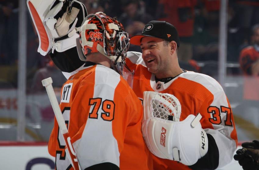 Carter Hart and Brian Elliott, Philadelphia Flyers (Photo by Bruce Bennett/Getty Images)