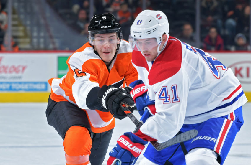 PHILADELPHIA, PA - NOVEMBER 07: Philippe Myers #5 of the Philadelphia Flyers stick checks Paul Byron #41 of the Montreal Canadiens during the third period at Wells Fargo Center on November 7, 2019 in Philadelphia, Pennsylvania. The Flyers won 3-2 in overtime. (Photo by Drew Hallowell/Getty Images)