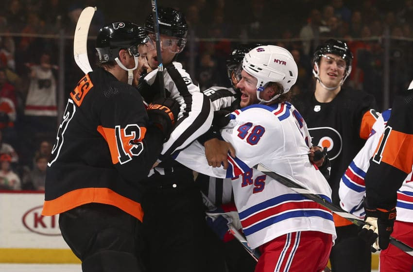 PHILADELPHIA, PA - DECEMBER 23: Kevin Hayes #13 of the Philadelphia Flyers gets in an altercation with Brendan Lemieux #48 of the New York Rangers in the third period at the Wells Fargo Center on December 23, 2019 in Philadelphia, Pennsylvania. The Flyers defeated the Rangers 5-1. (Photo by Mitchell Leff/Getty Images)