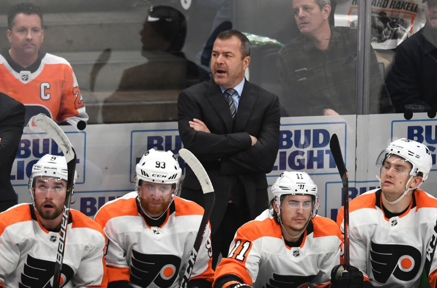 ANAHEIM, CA - DECEMBER 29: Philadelphia Flyers Head Coach Alain Vigneault behind his players on the bench in the second period of a game against the Anaheim Ducks played on December 29, 2019 at the Honda Center in Anaheim, CA. (Photo by John Cordes/Icon Sportswire via Getty Images)