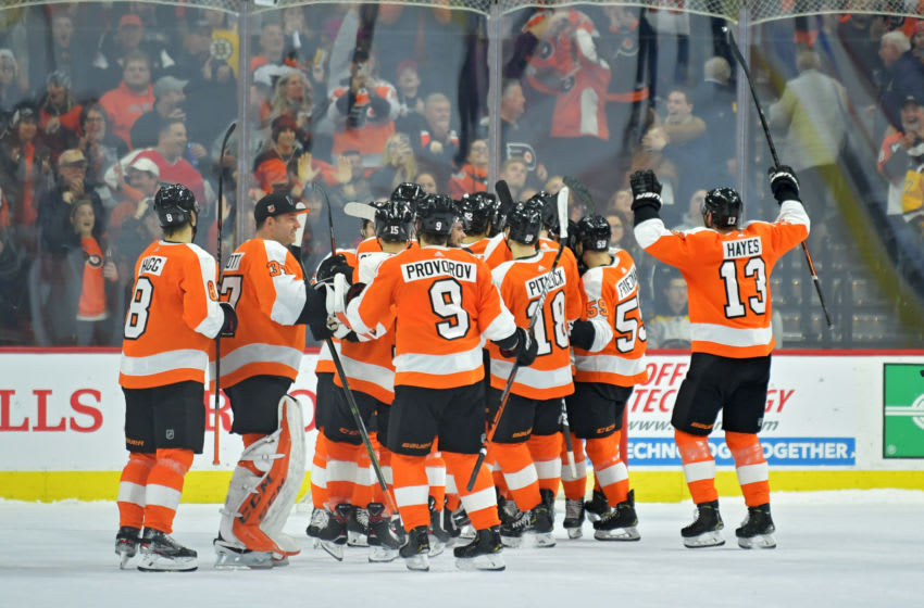 Members of the Philadelphia Flyers (Photo by Drew Hallowell/Getty Images)