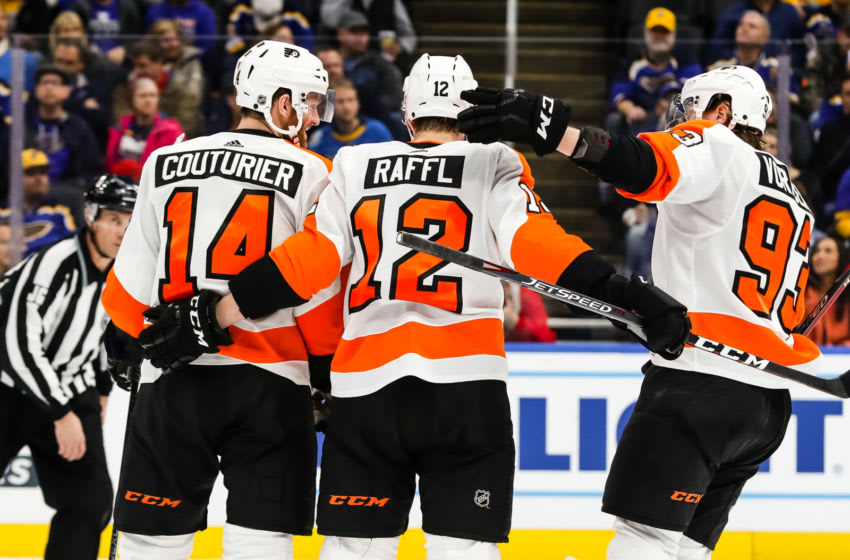 ST. LOUIS, MO - JANUARY 15: Philadelphia Flyers' Michael Raffl, center, is congratulated by his teammates after scoring a goal during the second period of an NHL hockey game between the St. Louis Blues and the Philadelphia Flyers on January 15, 2020, at the Enterprise Center in St. Louis, MO. (Photo by Tim Spyers/Icon Sportswire via Getty Images)