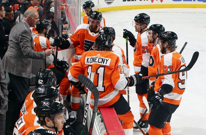 PHILADELPHIA, PA - JANUARY 21: Assistant Coach of the Philadelphia Flyers Michel Therrien talks to several of his players during a stoppage in play against the Pittsburgh Penguins on January 21, 2020 at the Wells Fargo Center in Philadelphia, Pennsylvania. (Photo by Len Redkoles/NHLI via Getty Images)