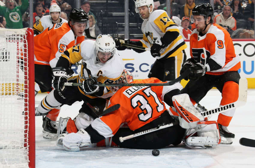 PHILADELPHIA, PA - JANUARY 21: Sidney Crosby #87 of the Pittsburgh Penguins attempts a scoring chance in the third period against Brian Elliott #37, Philippe Myers #5, and Ivan Provorov #9 of the Philadelphia Flyers on January 21, 2020 at the Wells Fargo Center in Philadelphia, Pennsylvania. (Photo by Len Redkoles/NHLI via Getty Images)