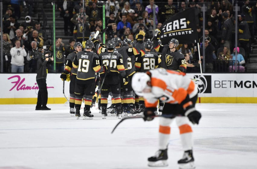 LAS VEGAS, NEVADA - JANUARY 02: The Vegas Golden Knights celebrate after defeating the Philadelphia Flyers at T-Mobile Arena on January 02, 2020 in Las Vegas, Nevada. (Photo by Jeff Bottari/NHLI via Getty Images)