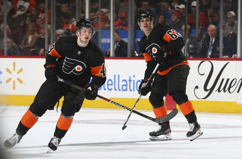 PHILADELPHIA, PA - JANUARY 11: Joel Farabee #49 and Nicolas Aube-Kubel #62 of the Philadelphia Flyers in action against the Tampa Bay Lightning at the Wells Fargo Center on January 11, 2020 in Philadelphia, Pennsylvania. The Lightning defeated the Flyers 1-0. (Photo by Mitchell Leff/Getty Images)