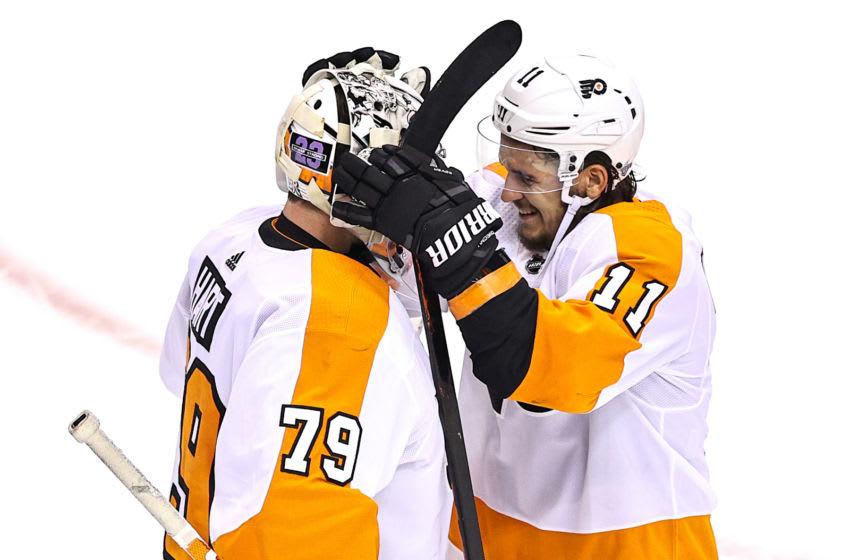 Carter Hart and Travis Konecny, Philadelphia Flyers (Photo by Elsa/Getty Images)