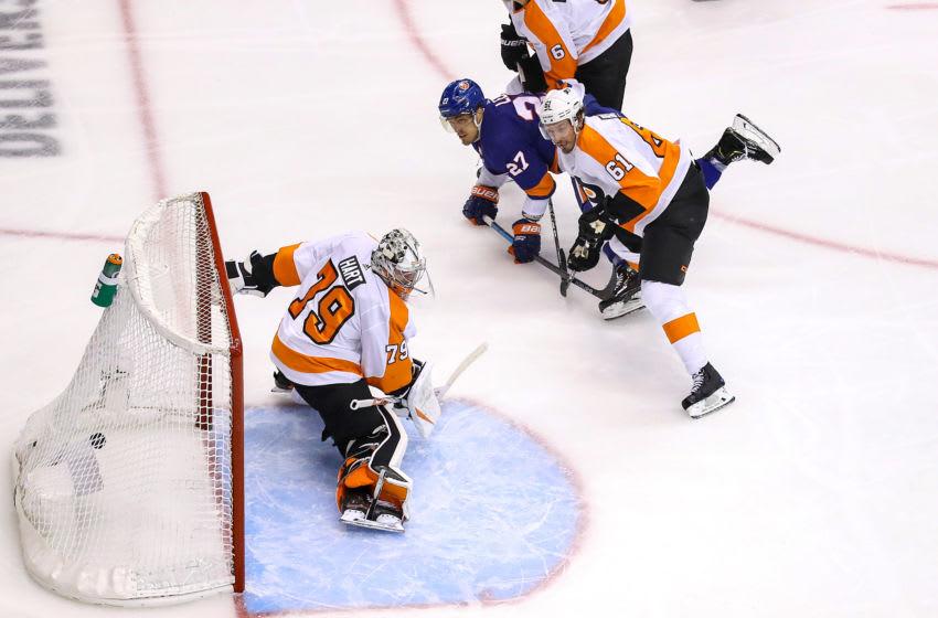 Anders Lee, New York Islanders and Carter Hart, Philadelphia Flyers (Photo by Elsa/Getty Images)