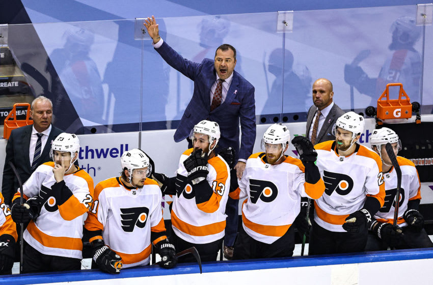 TORONTO, ONTARIO - SEPTEMBER 03: Head coach Alain Vigneault of the Philadelphia Flyers reacts against the New York Islanders during the first overtime period in Game Six of the Eastern Conference Second Round during the 2020 NHL Stanley Cup Playoffs at Scotiabank Arena on September 03, 2020 in Toronto, Ontario. (Photo by Elsa/Getty Images)