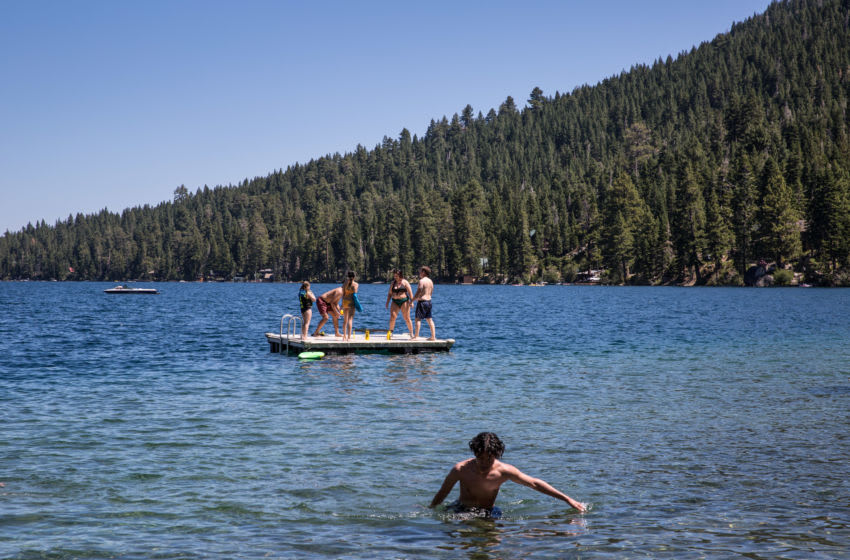SOUTH LAKE TAHOE, CA - AUGUST 9: Kids enjoy a sunny day at Fallen Leaf Lake, located adjacent to Lake Tahoe near Emerald Bay, on August 9, 2020, in South Lake Tahoe, California. Lake Tahoe has proven to be a major destination this summer for Covid-19 weary tourists hoping to trade the pandemic for the clean air, camping, and water sports found at this Sierra Nevada Mountain Range high altitude lake. (Photo by George Rose/Getty Images)