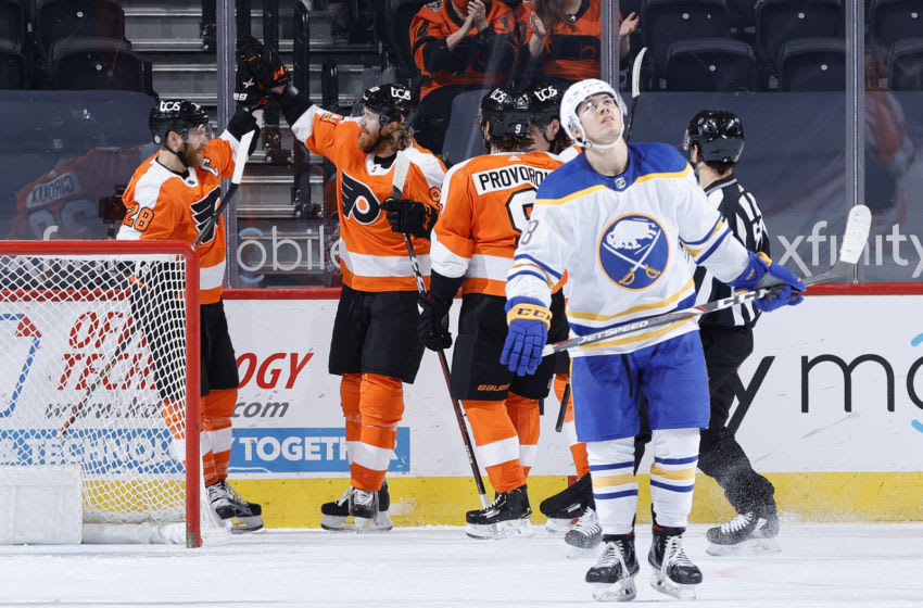 PHILADELPHIA, PENNSYLVANIA - MARCH 09: Claude Giroux #28 of the Philadelphia Flyers celebrates with teammates after scoring during the second period against the Buffalo Sabres at Wells Fargo Center on March 09, 2021 in Philadelphia, Pennsylvania. (Photo by Tim Nwachukwu/Getty Images)