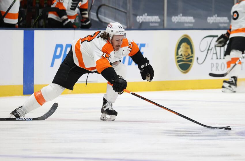 UNIONDALE, NEW YORK - MARCH 20: Kevin Hayes #13 of the Philadelphia Flyers in action against the New York Islanders during their game at Nassau Coliseum on March 20, 2021 in Uniondale, New York. (Photo by Al Bello/Getty Images)