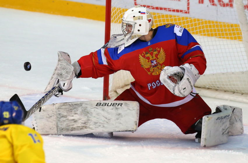 POPRAD, SLOVAKIA - APRIL 23, 2017: Russia's goaltender Kirill Ustimenko makes a save in their 2017 IIHF World U18 Championship ice hockey match against Sweden at the Poprad Ice Stadium. Russia won the game 3-0 and became the bronze champion. Yelena Rusko/TASS (Photo by Yelena RuskoTASS via Getty Images)