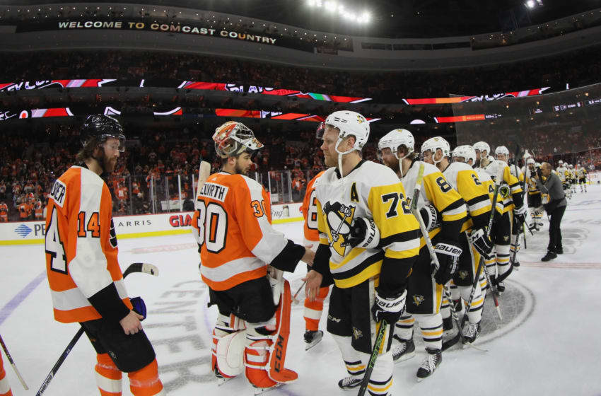 PHILADELPHIA, PA - APRIL 22: The Philadelphia Flyers and the Pittsburgh Penguins shake hands following Game Six of the Eastern Conference First Round during the 2018 NHL Stanley Cup Playoffs at the Wells Fargo Center on April 22, 2018 in Philadelphia, Pennsylvania. The Penguins defeated the Flyers 8-5. (Photo by Bruce Bennett/Getty Images)