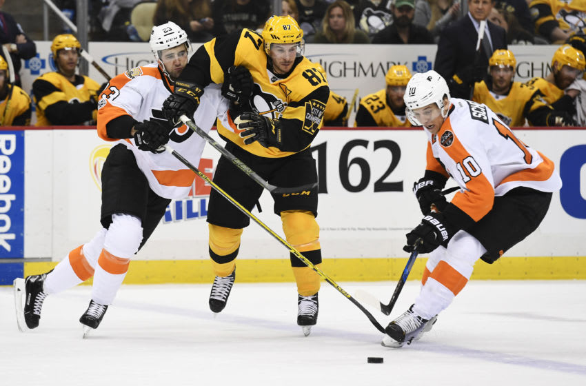 PITTSBURGH, PA - MARCH 26: Pittsburgh Penguins Center Sidney Crosby (87) goes for the puck between Philadelphia Flyers Defenseman Brandon Manning (23) and Philadelphia Flyers Left Wing Brayden Schenn (10) during the second period in the NHL game between the Pittsburgh Penguins and the Philadelphia Flyers on March 26, 2017, at PPG Paints Arena in Pittsburgh, PA. (Photo by Jeanine Leech/Icon Sportswire via Getty Images)