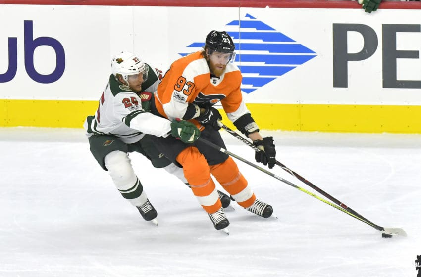 PHILADELPHIA, PA - NOVEMBER 11: Philadelphia Flyers right wing Jakub Voracek (93) keep the puck away from Minnesota Wild defenseman Jonas Brodin (25) during the NHL game between the Minnesota Wild and the Philadelphia Flyers on November 11, 2017 at the Wells Fargo Center in Philadelphia PA. (Photo by Gavin Baker/Icon Sportswire via Getty Images)