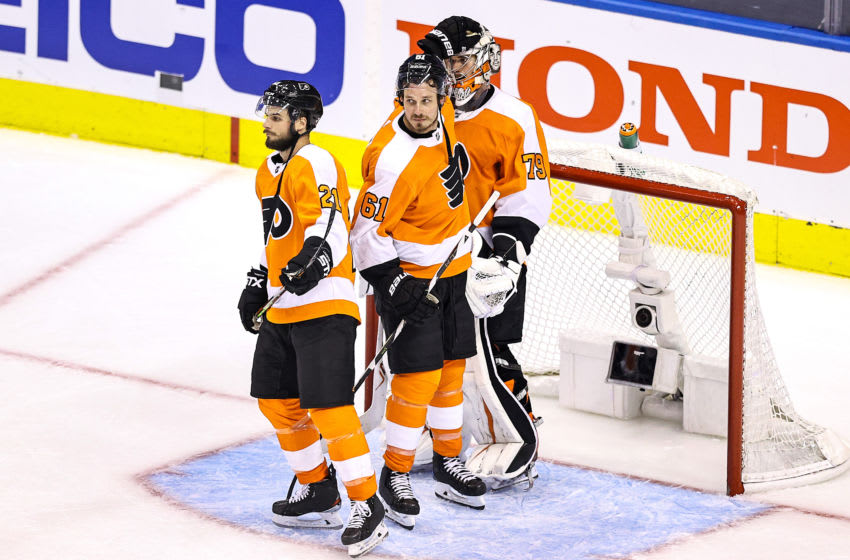 Carter Hart, Justin Braun and Scott Laughton, Philadelphia Flyers (Photo by Elsa/Getty Images)