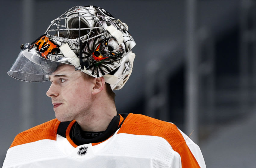 BOSTON, MASSACHUSETTS - JANUARY 21: Carter Hart #79 of the Philadelphia Flyers looks on during the first period against the Boston Bruins at TD Garden on January 21, 2021 in Boston, Massachusetts. (Photo by Maddie Meyer/Getty Images)