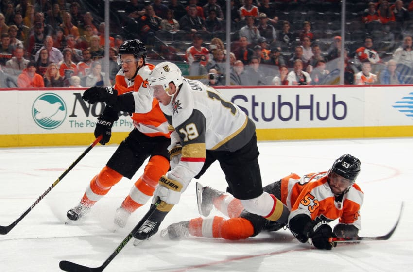 PHILADELPHIA, PENNSYLVANIA - OCTOBER 21: Robert Hagg #8 and Shayne Gostisbehere #53 of the Philadelphia Flyers defend against Reilly Smith #19 of the Vegas Golden Knights at the Wells Fargo Center on October 21, 2019 in Philadelphia, Pennsylvania. (Photo by Bruce Bennett/Getty Images)