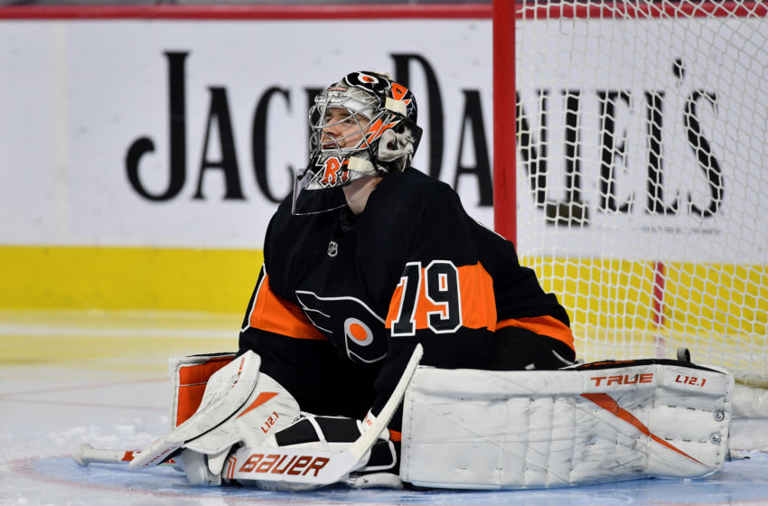 Apr 11, 2021; Philadelphia, Pennsylvania, USA; Philadelphia Flyers goalie Carter Hart (79) stretches in the third period against the Buffalo Sabres at Wells Fargo Center. Mandatory Credit: Kyle Ross-USA TODAY Sports