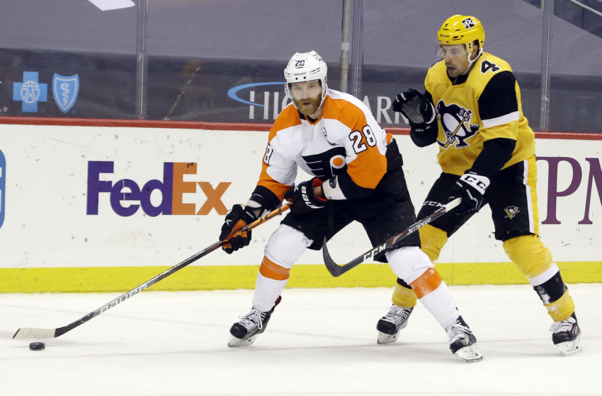 Mar 4, 2021; Pittsburgh, Pennsylvania, USA; Philadelphia Flyers center Claude Giroux (28) skates with the puck against Pittsburgh Penguins defenseman Cody Ceci (4) during the third period at PPG Paints Arena. The Flyers won 4-3. Mandatory Credit: Charles LeClaire-USA TODAY Sports